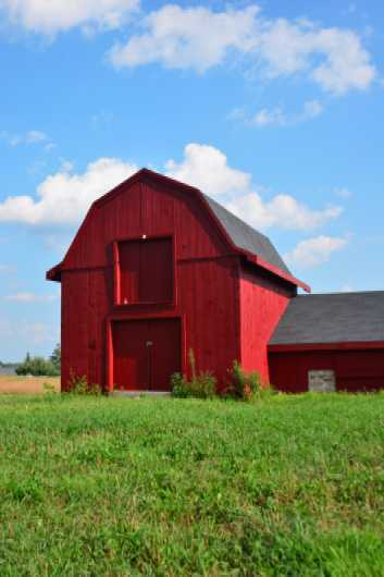 Old red barn against blue sky in Hollis NH from the Barns collection by jndphoto