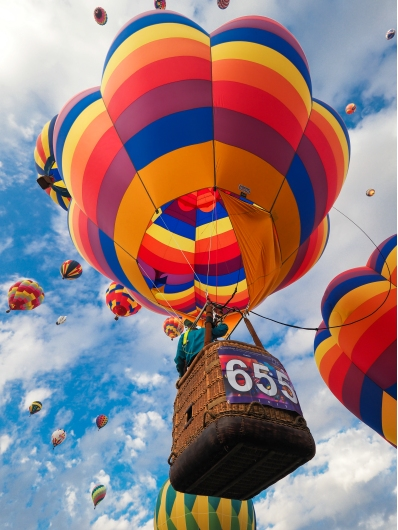 Brightly Colored Hot Air Balloons Light Up Sky from the Gallery collection by Alex McClure