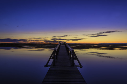 Warm Blue Boardwalk Reflection from the Sunrise/Sunset Photos collection by TJ Walsh Photography